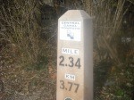 A mile marker on the towpath helps us measure the run.